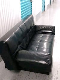 like new. leather   futon  couch. with adjustable arms Fort Myers