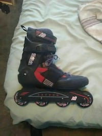 unpaired black and red inline skate