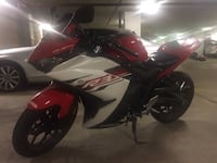 black and red sports bike