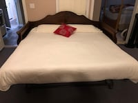 Brown wooden bed frame with white mattress. Converts to a daybed. Please call  [TL_HIDDEN]  Burnaby, V3N 2K1