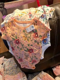 baby's pink and green floral onesie