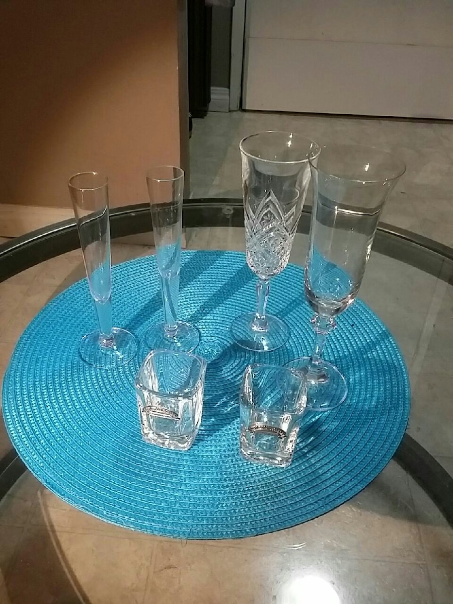 four champagne flute and shot glasses