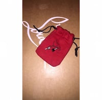 red and black LouBoutin drawstring pouch Chevy Chase, 20815