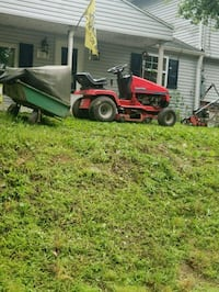 red and black riding mower York, 17402