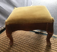 Small vintage footstool with gold velvet top and wood legs-decent vintage condition, but velvet is tearing at the corners- was going to repurpose into a fancy dog bed for my T-Cup yorkie, but just haven't gotten to it. Very Cute- vintage style.