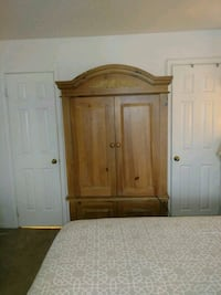 King bed and armoire.