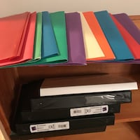 Stack of binders and folders