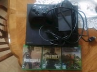 black Xbox One console with controller and game cases New Kensington, 15068