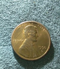 1990 round gold-colored Liberty coin Los Angeles, 91342