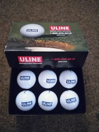 white and green golf balls  509 km