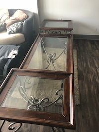 glass top brown wood-framed 3-piece coffee tables