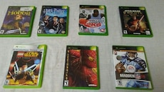seven assorted Xbox game case