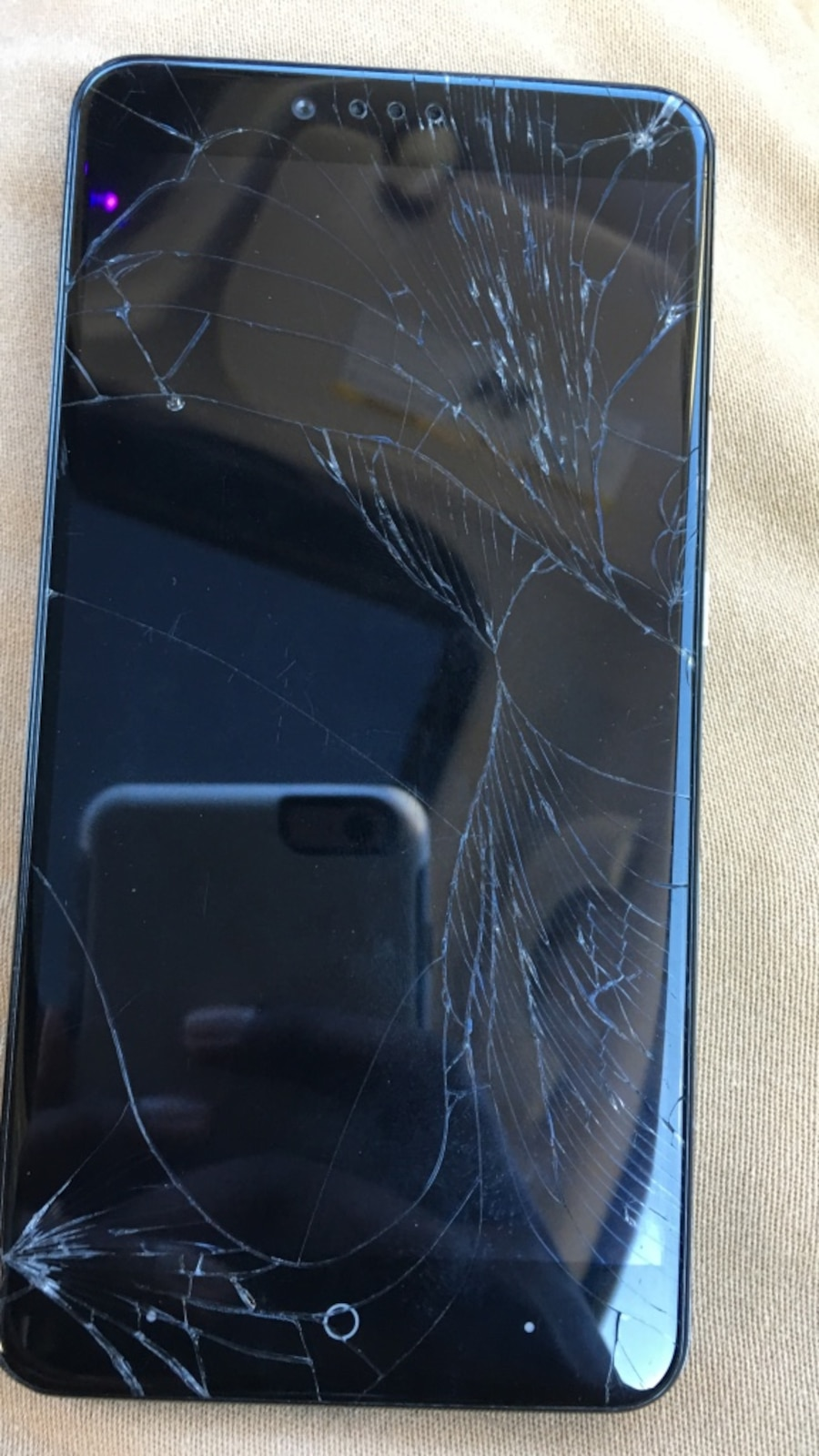 black cracked android smartphone