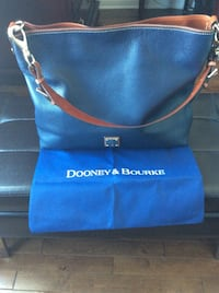 Authentic Dooney & boorke high quality leather large handbag barley used.  Laval, H7X 3M8