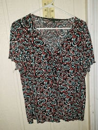 black, red, and white floral scoop neck shirt Reno
