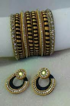 yellow and black bangles and pair of hoop earrings