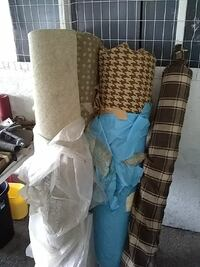 four rolled textiles