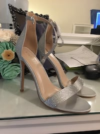 pair of gray peep-toe platform stilettos 1164 mi