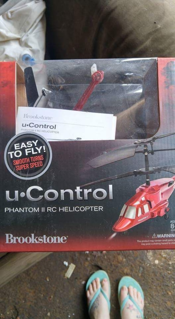 red and black Brookstone radio-controlled helicopter with box