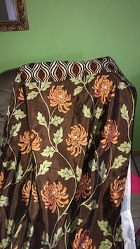 Curtains peir one. Brown with orange flowers. Liner. 3 panels Saint Louis, 63123