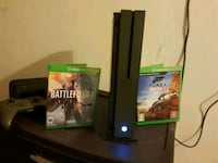 black Xbox 360 console with game cases New York, 10463