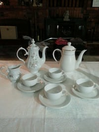 white teapots, teacups with saucers set