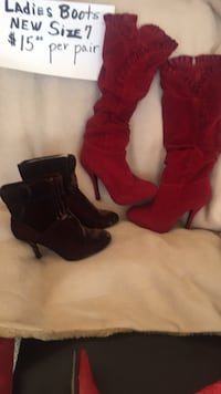 two pairs of black suede round toe kitten heeled booties and red suede round toe stiletto knee-high boots \ Hickory, 28602