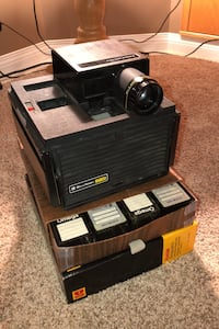 Bell and Howell slide cube projector and cases