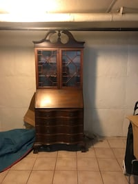Brown wooden cabinet desk, key included.