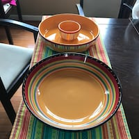 Chip and dip set, nesting melamine bowls and melamine pitcher from Crate and Barrel and a service platter in similar bright colors. All for $10.