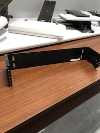 Wall mounted bracket for networking equipment