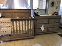 Black wooden crib with changing table Richmond Hill, L4C 6B9