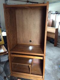 Brown wooden Computer/tv hutch with doors and top shelf( not shown) by Crate design