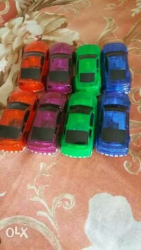 four assorted color die-cast cars New Delhi, 110070