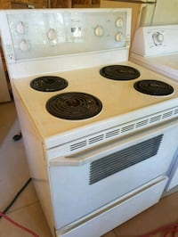 white and black electric coil range oven London, N6J 1W6