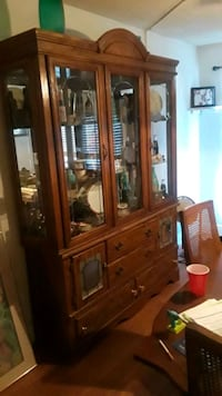 brown wooden china cabinet with glass display cabi Pensacola, 32506