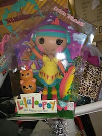 yellow dressed Lalaloopsy doll with clear plastic pack