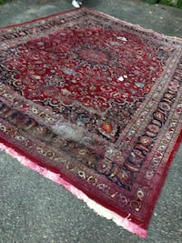 Large Persian rug damaged