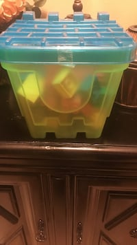 black and green plastic container