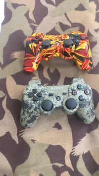 two black and white camouflage Sony PS4 controllers Washington, 20009