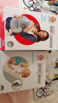 two Infant insert and baby carrier boxes