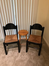 Two black wooden framed brown padded chairs Silver Spring