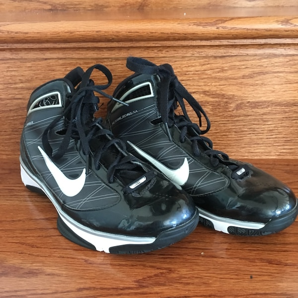 Pair of black nike Hyperize basketball shoes