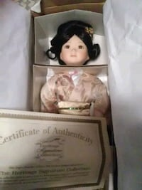two white and black dressed doll in box Hagerstown