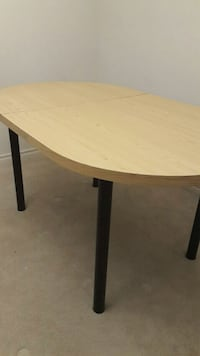 round brown wooden table with black metal base London, N6H 0B3