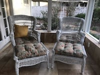 Wicker swivel chairs with foot rests