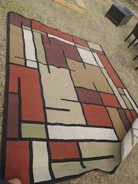 brown, red, and black area rug