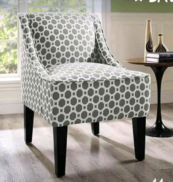 brown and white leopard print padded chair