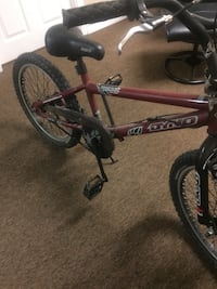 red and black Mongoose BMX bike