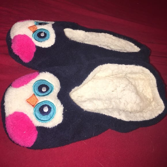 Cute penguin slippers. Worn only once..